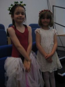 Feeling proud (and a little camera shy) after a great performance: Heather and Madeleine, two of the Wood Nymphs